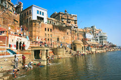 People worshiping bathing in the River Ganges. People worshiping bathing in the sacred River Ganges during a religious ceremony at Uttar Pradesh in Varanasi Stock Images