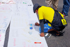 People write on lable for against the construction of a dam in Mae Wong National Park Stock Photo