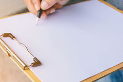 People are writing a message on it paper on clipboard Royalty Free Stock Photos