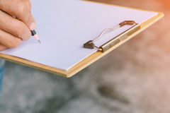 People are writing a message on it paper on clipboard Stock Photos