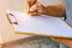 People are writing a message on it paper on clipboard Royalty Free Stock Photo