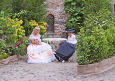 People in XIX century costume Royalty Free Stock Photo