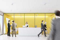 People yellow reception, front. Businesspeople are wallking past a reception with yellow walls meeting room in the background. 3d rendering Stock Photo