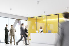 People yellow reception, side. Businesspeople are wallking past a reception with yellow walls meeting room in the background. Side view. 3d rendering Stock Photo