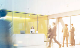 People yellow reception, side, toned. Businesspeople are wallking past a reception with yellow walls meeting room in the background. Side view. 3d rendering Royalty Free Stock Photography