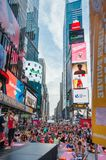 People in the yoga annual concentration in Times Square, New York City, USA. NEW YORK CITY, USA - JUNE 21, 2016: People in the yoga annual concentration on the stock photo
