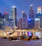 People Yoga city Downtown  Singapore. SINGAPORE - JAN 15, 2017: People practicing yoga in Downtown of Singapore at night Stock Photo