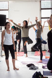 People at Yoga Festival in Milan, Italy. MILAN, ITALY - OCTOBER 11: People take a class at Yoga Festival 2013, event dedicated to yoga, meditation and healthy Stock Photo