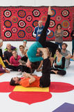 People at Yoga Festival in Milan, Italy. MILAN, ITALY - OCTOBER 11: People take a class at Yoga Festival 2013, event dedicated to yoga, meditation and healthy Stock Images