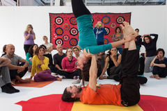 People at Yoga Festival in Milan, Italy. MILAN, ITALY - OCTOBER 11: People take a class at Yoga Festival 2013, event dedicated to yoga, meditation and healthy Royalty Free Stock Images