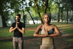 People yoga in a park stock photo