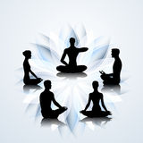 People in yoga poses Stock Photo