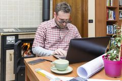 Young man works remotely through internet connection. People: Young man works remotely through internet connection stock photos