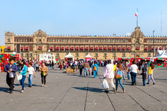 People at the Zocalo or Constitution Square on a beautiful day in Mexico City Royalty Free Stock Photos