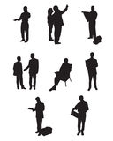Peoples. Black silhouettes of working people Stock Photography