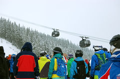 Peoples and cabines of lift. Royalty Free Stock Images