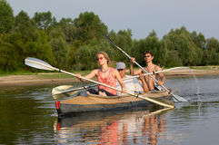 Peoples on canoe Royalty Free Stock Photo