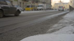 Peoples and cars on street in winter blurred