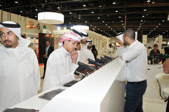 Peoples checking Pistols at Abu Dhabi International Hunting and Equestrian Exhibition 2013 Royalty Free Stock Images