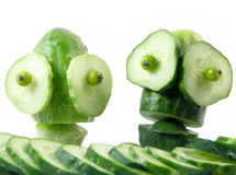 Peoples of cucumbers stock images