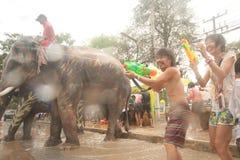 Peoples and elaphant enjoy splashing water in Songkran festival. AYUTTAYA, THAILAND - APRIL 15: Thai people enjoy splashing water together in songkran festival stock image
