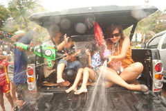 Peoples enjoy splashing water in Songkran festival. Royalty Free Stock Photos