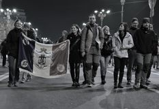 Peoples with flag on the street from Bucharest