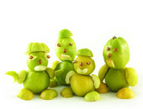 Peoples from fruits of quinces Stock Photography