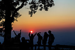 Peoples had happy motion, silhouetted with sunset Royalty Free Stock Images
