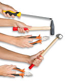 Peoples hands holding tools. Peoples hands holding different tools on isolated white background Royalty Free Stock Photos