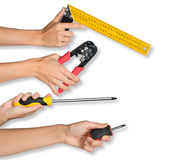 Peoples hands holding tools. Peoples hands holding different tools on isolated white background royalty free stock photo