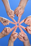Peoples hands pointing at one spot Stock Images