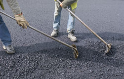 Peoples labor for paving Stock Image