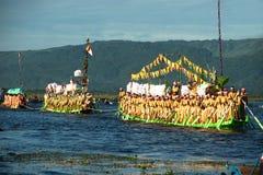 Peoples paddle by legs in Phaung Daw Oo Pagoda festival,Myanmar. Stock Photo