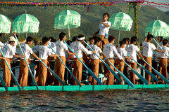 Peoples paddle by legs in Phaung Daw Oo Pagoda festival,Myanmar. Royalty Free Stock Image