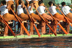 Peoples paddle by legs in Phaung Daw Oo Pagoda festival,Myanmar. Stock Images