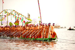 Peoples paddle by legs in Phaung Daw Oo Pagoda festival,Myanmar. Royalty Free Stock Images