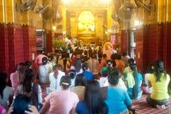 Peoples praying Maha Muni Buddha. Royalty Free Stock Image
