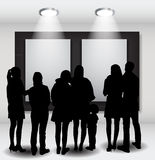 Peoples Silhouettes Looking on the Empty Frame in Art Gallery fo Royalty Free Stock Images