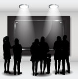 Peoples Silhouettes Looking on the Empty Frame in Art Gallery fo Royalty Free Stock Photography