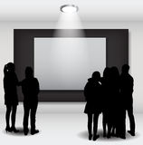 Peoples Silhouettes Looking on the Empty Frame in Art Gallery fo Stock Photos