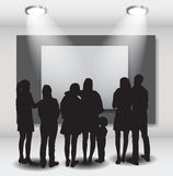 Peoples Silhouettes Looking on the Empty Frame in Art Gallery fo Royalty Free Stock Photo