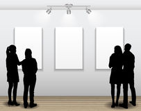 Peoples Silhouettes Looking on the Empty Frame in Art Gallery fo Stock Images