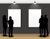 Peoples Silhouettes Looking on the Empty Frame in Art Gallery fo Royalty Free Stock Image