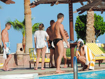 Peoples at Swimming Pool. Egypt, Nov. 23 2014 : Happy people and girls in bikini enjoying bath time in pool, Sharm el-Sheikh Stock Image