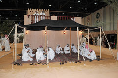 Peoples in tent at Abu Dhabi International Hunting and Equestrian Exhibition (ADIHEX) Stock Image