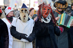 Peoples in traditional masks Stock Image