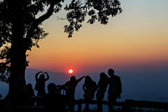Peoples and trees silhouetted with sunset Royalty Free Stock Photography