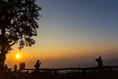 Peoples and trees silhouetted with sunset Royalty Free Stock Images