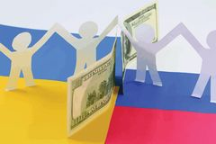 The peoples of Ukraine and Russia friendly despite us sanctions. Concept :Russia and Ukraine are separated by a wall of American dollars Stock Images